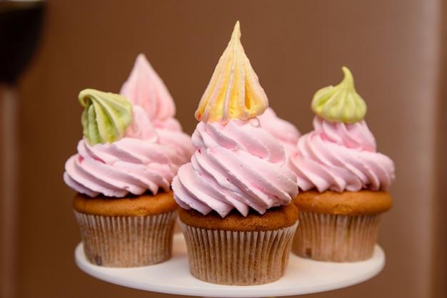Multi colored cream cup cakes