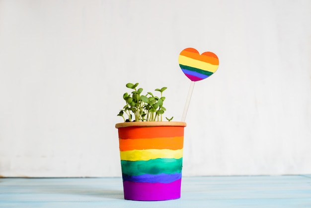 Multi colored drawing by paints. potted rainbow, young sprouts, colorful flower.multi-colored drawing by paints. bright card.equality betwee. lgbt concept. lesbian gay , bisexual transsexual