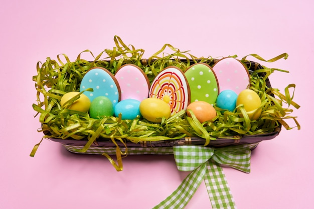 Multi colored egg shaped cookies in wicker basket
