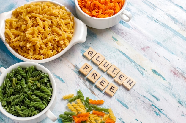 Multi-colored gluten free vegetable fusilli pasta.
