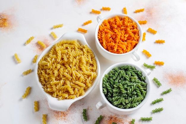 Multi-colored gluten free vegetable fusilli pasta.