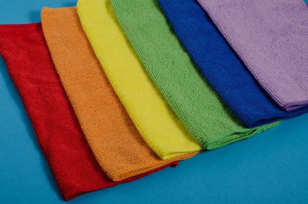 Multi-colored napkins in rainbow colors on a blue space