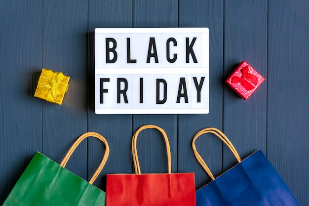 Multi - colored packaging bags, gift boxes lightbox with text black friday