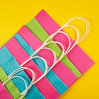 Multi colored paper shopping bags with white handles
