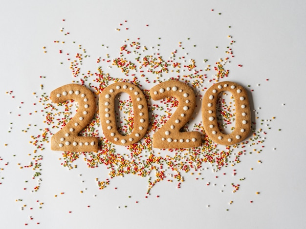 Multi colored pastry sugar topping and gingerbread in the form of numbers 2020
