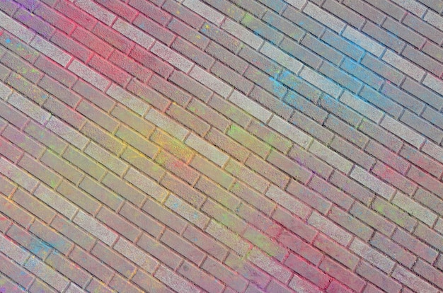Multi colored paving slabs, powder coated with dry colors at the holi festival