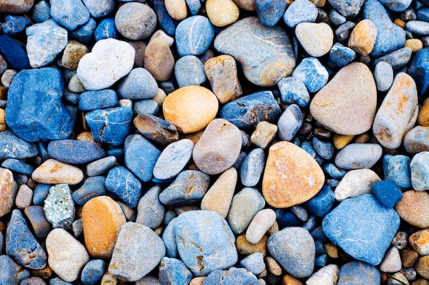 Multi colored pebbles rocks background