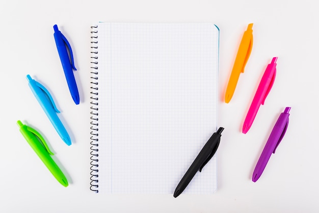 Multi-colored pens with notebook