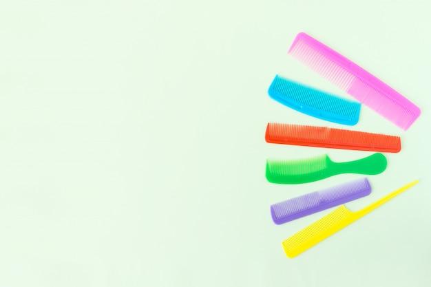 Multi-colored plastic hair comb crest brushes