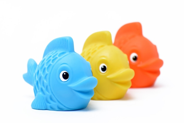 Multi-colored rubber toy fish on a white background