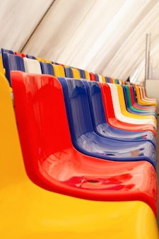 Multi-colored seats. indoor ice rink
