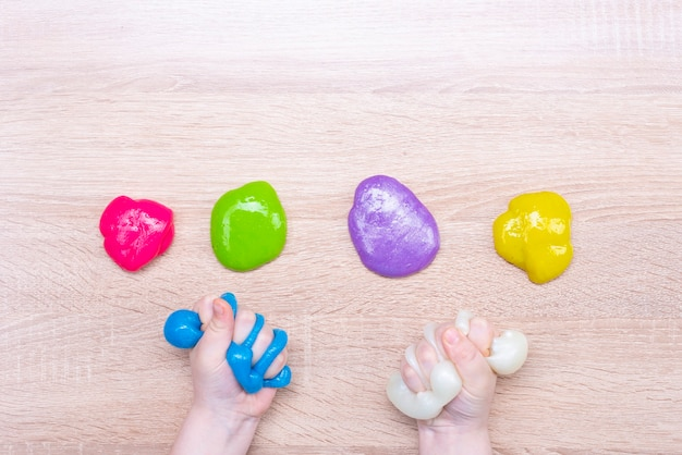 Multi-colored slimes on the table