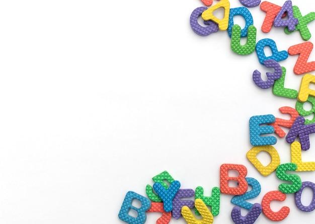 Разноцветные мягкие английские буквы и цифры на белом