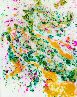 Multi colored textured backdrop mixed with liquid