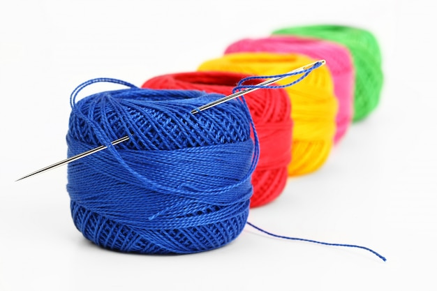 Multi-colored threads for sewing in a composition on a white space