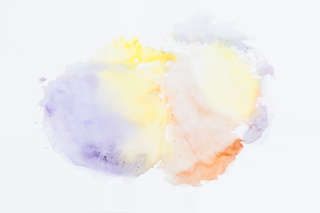 Multi colored watercolor mixed on white background