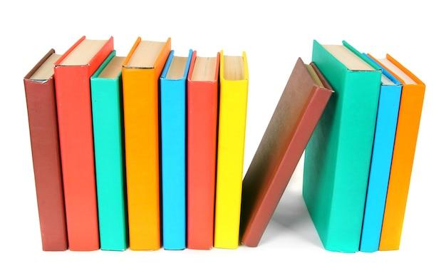 マルチカラーの本。白い背景に。 Premium写真