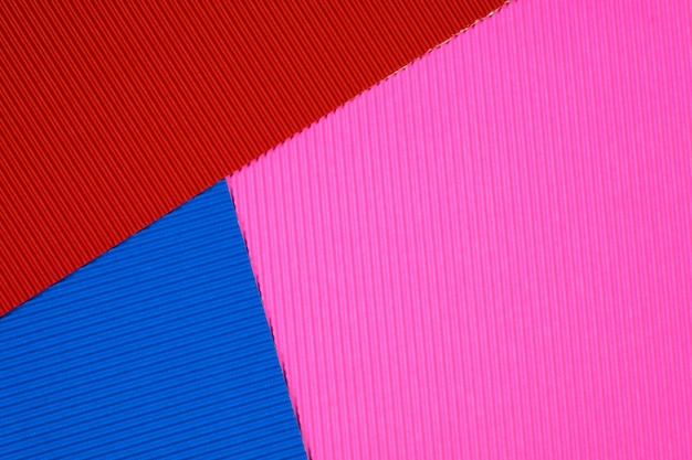 Multi coloured corrugated paper texture background