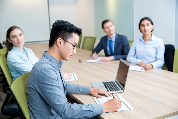 Multi-ethnic business people attending seminar