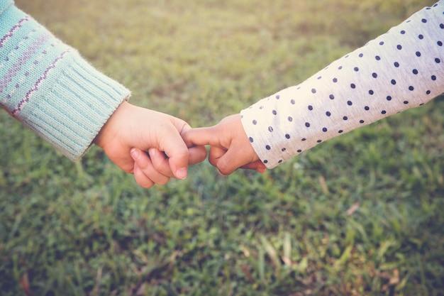 Multi-ethnic chidren holding hands for peace, diversity, friendship concept