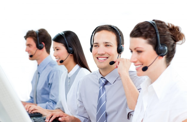Multi-ethnic customer service agents working in a call center