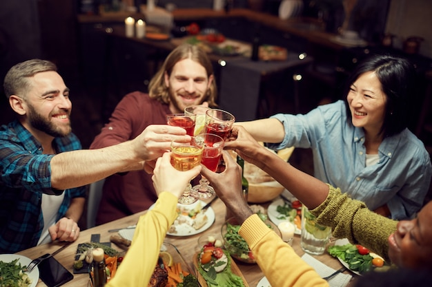 Multi-ethnic group of people clinking glasses