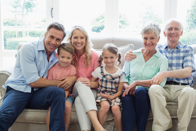 Multi generation family sitting on sofa in living room