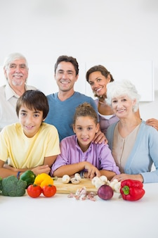 Multi generation family smiling in kitchen