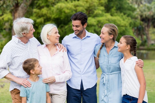 Multi-generation family standing in park