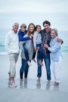 Multi-generation family standing at sea shore