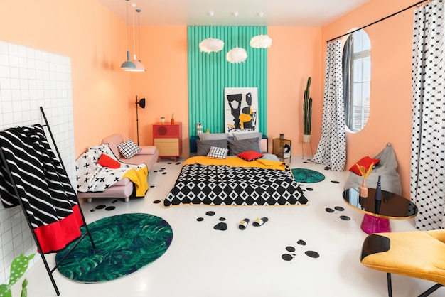 Multicolor bedroom with geometrical patterns in interior and textile.