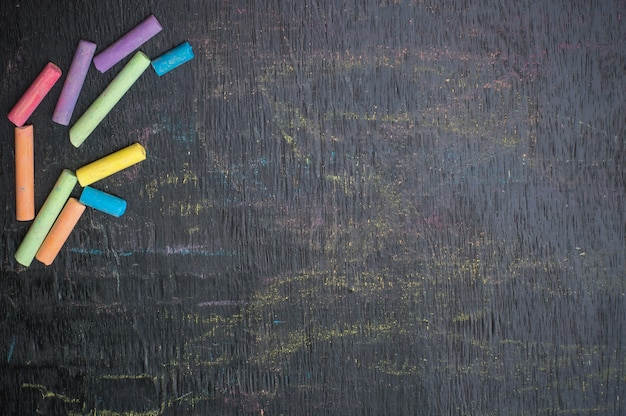 Multicolor chalk on backboard for education background