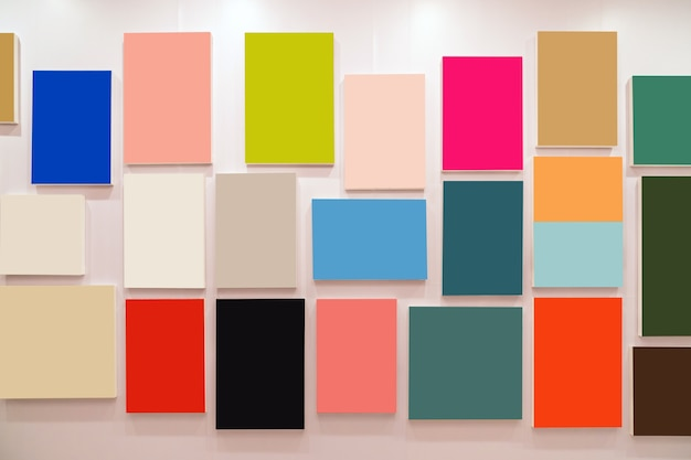 Multicolor photo frames over the wall background, interior gallery