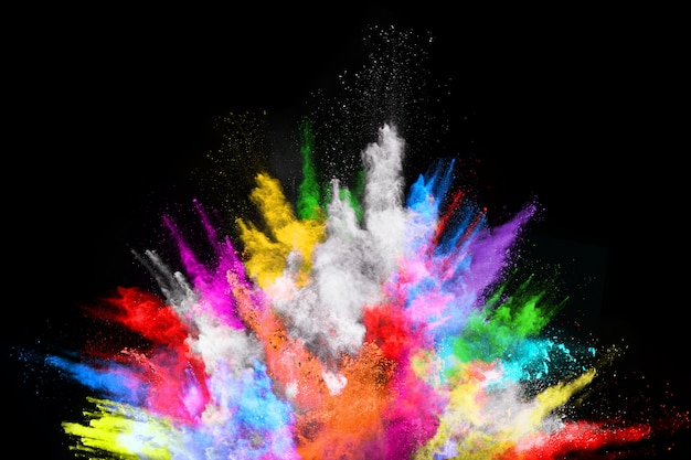 Multicolor powder explosion on black background.