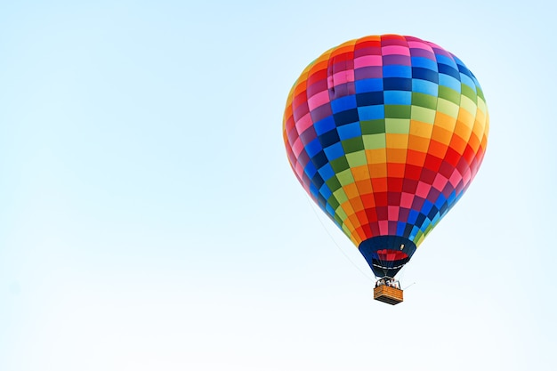 Multicolored air balloon in clear blue sky