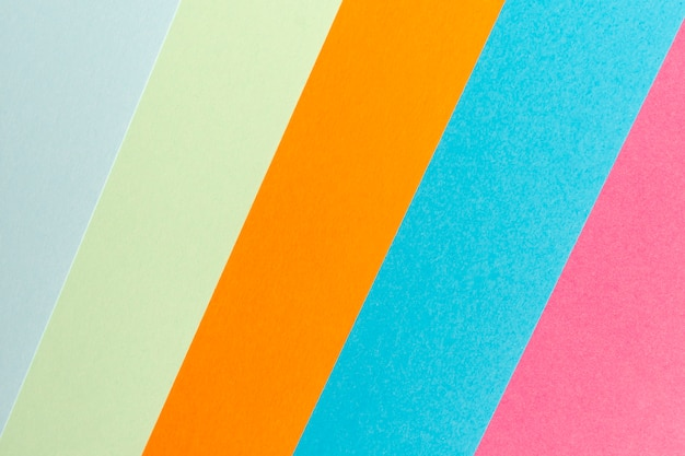 Multicolored aligned paper sheets background