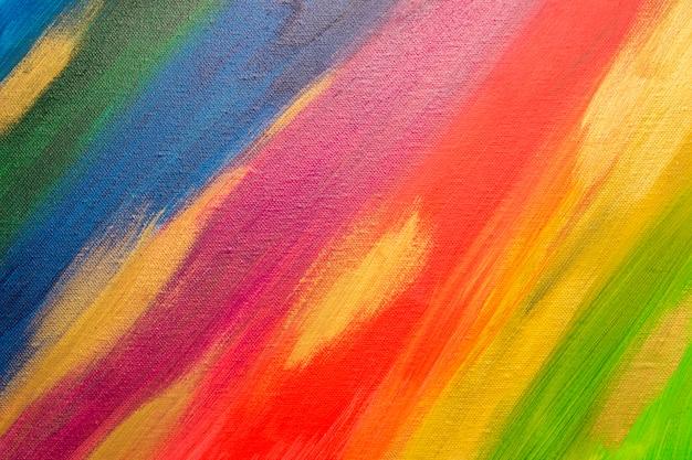 色とりどりの背景。キャンバスにペイントします。手描きの抽象的なアクリルの背景。