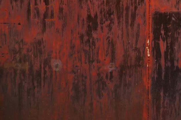 갈색 페인트 자연 결함이 벗겨지고 갈라지는 여러 가지 빛깔의 배경 녹슨 금속 표면...