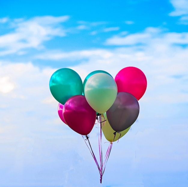 Multicolored balloons, sky, concept of happy birthday in summer and wedding honeymoon party