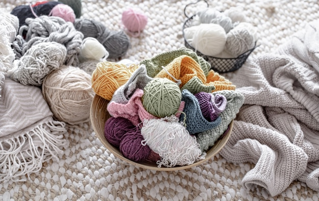 Multicolored balls of thread for knitting in the basket.