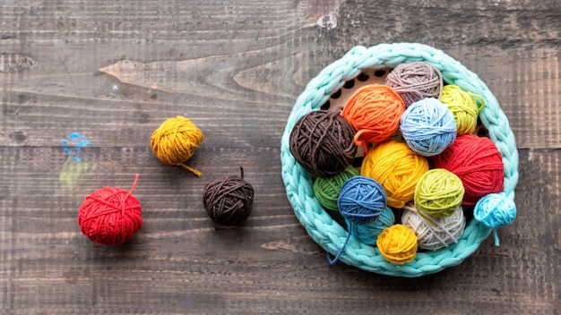 Multicolored balls of yarn in and near the knitted couch