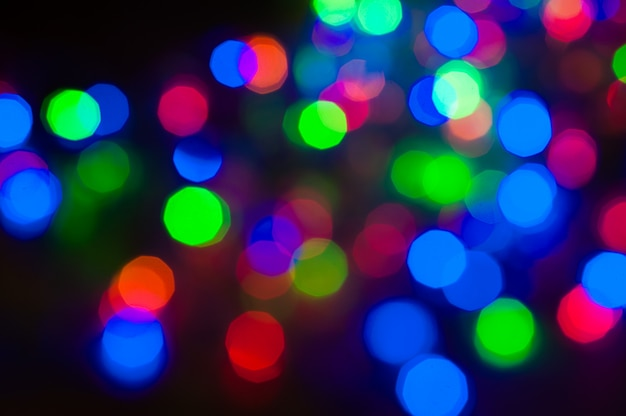 Multicolored blurry lights at night. holiday christmas