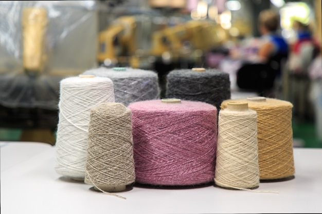 Multicolored bobbins of wool for knitting