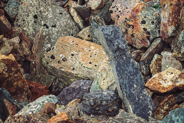 Multicolored boulder stream. loose rock close up. randomly scattered stones in nature.