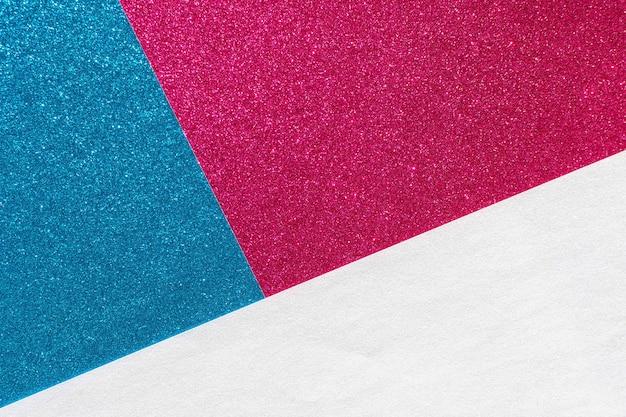 色とりどりの明るい光沢のある粒子の粗い背景、キラキラ抽象的な背景