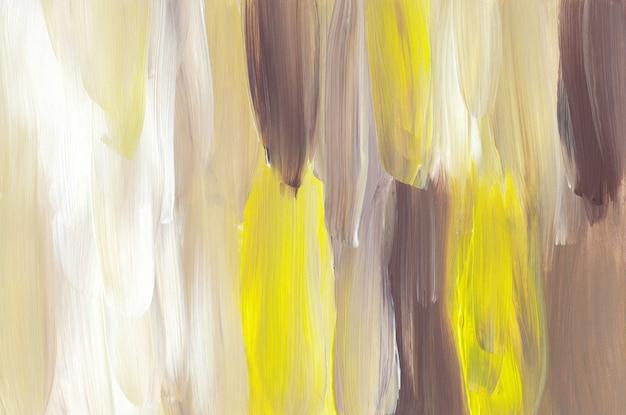 Разноцветные мазки фон, желтый, коричневый, белый мазки на бумаге