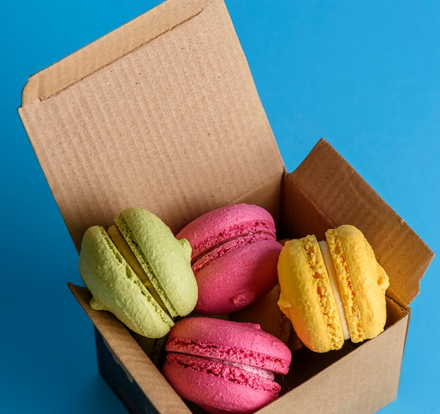 Multicolored cakes of almond flour in a brown paper box