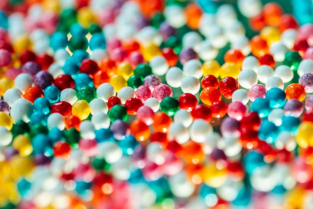 Multicolored candy on a green background