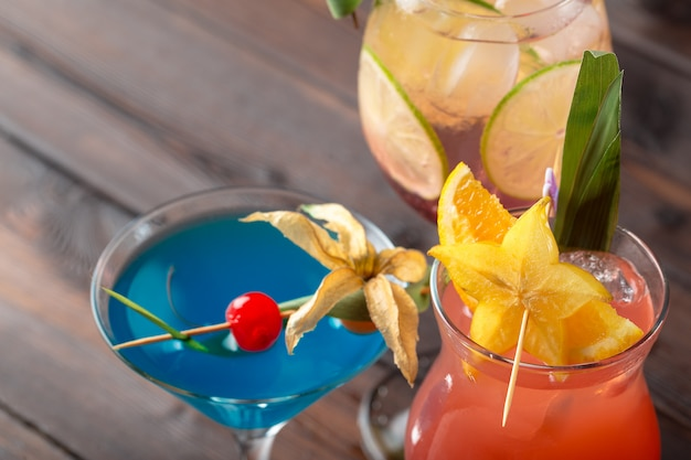 Multicolored cocktails at the bar close up shot