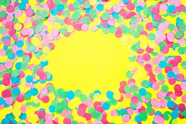 Multicolored confetti on a yellow background. gala concert